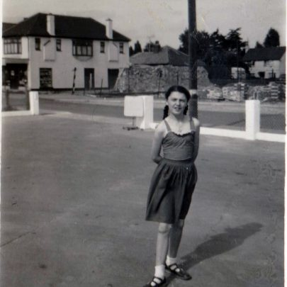 Dee on the forecourt 1960 with Vanderwalt Avenue in the backgroung and start of building work of new flats&shops.