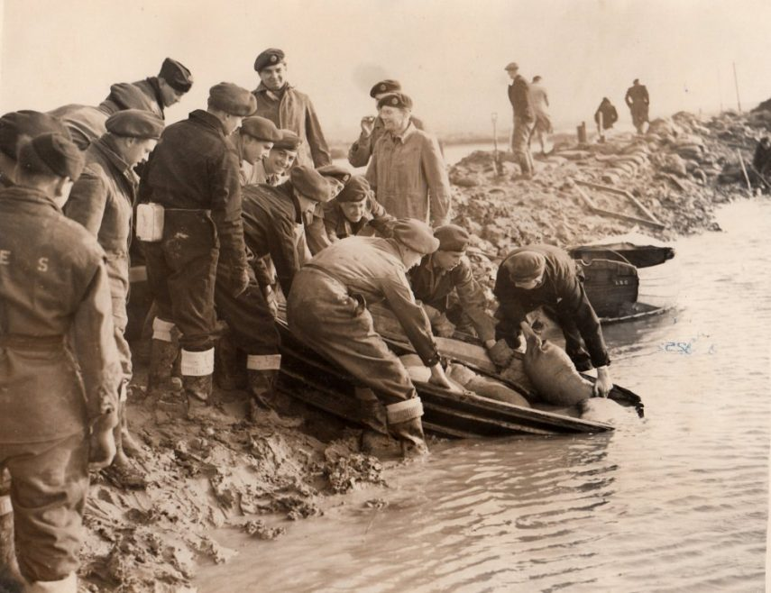On the back - Members of the RAF sink boats full of sand bags, which they ferried to one of the gaps. | Dated 4th Feb