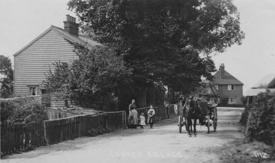 This is totally new to me. c1910.Taken from Long Road towards the junction with Haven Road. You can just see the village pump behind the cart. Looks like the cart is delivering coal as the lady has a bucket in each hand. | Lin and Michael Swanson