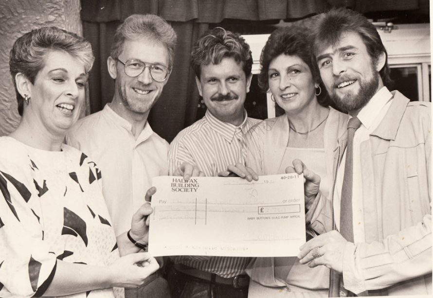 Denise, left, presents the cheque to Mr and Mrs Button, right, with Mr Gover, centre and Mr Sheridan | Echo Newspaper Group