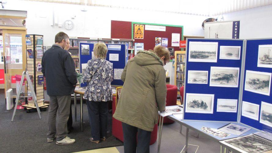 Browsing the Flood Exhibition.   J.Walden