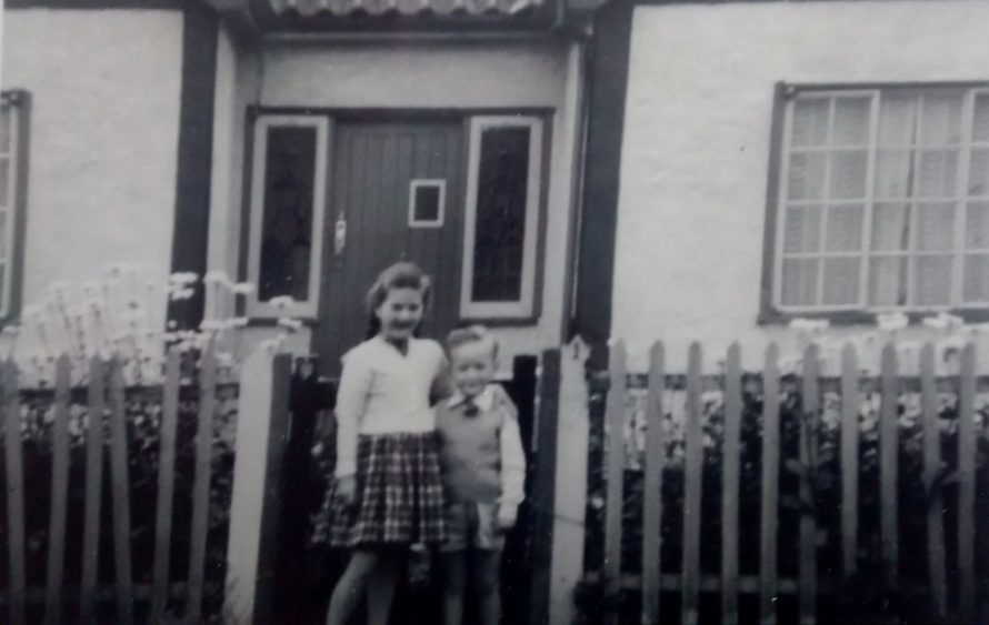 Gary with his sister outside their house | Gary Foulger