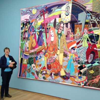 Nellie Verton standing beside the Canvey Tapestry called 'The Perfect Match' | N Verton