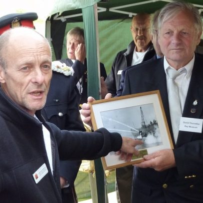 Roger Pickett of the Essex Fire Museum presenting Dave Thorndike with a picture for the museum | Janet Penn
