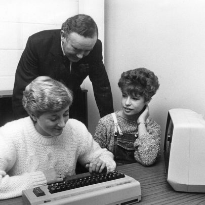 Peter Morrison Minister of State for employment at the opening in the computer room with Lisa Stephen on the left and Allison Rood right. Taken November 1983 | Echo Newspaper Group