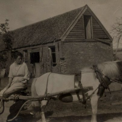 George's mother Doris on a milk-cart pulled by Tim ,the pony. | G.Chambers