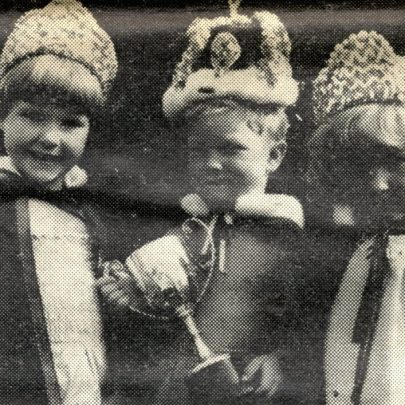 Champion toddler Michael Bowers (centre) with runnersup Kim Kruger and Belinder Campbell
