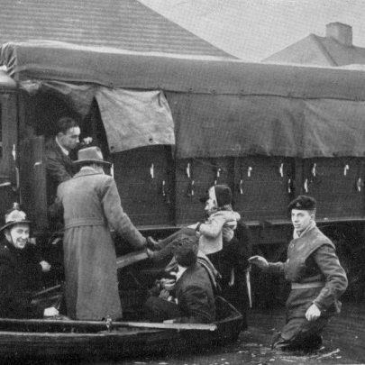 A child is transfered from a rescue boat to an army lorry at Canvey Island
