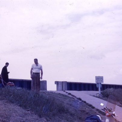 The old seawall built in 1953. John Attwood with Chas Carey in lifeguard uniform watching
