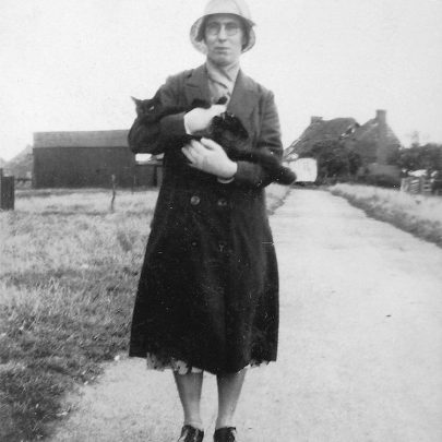 Ada Deadman in road in front of Chase cottages with Brick house Farm in background | Joyce Cowell