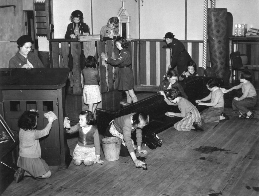 another great picture of the inside of St Anne's Church with the Guides and Brownies helping to clean-up after the floods of 1953 | Phyllis Owens