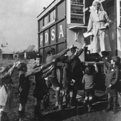 The local kids seem very keen to receive what appear to be pamphlets from the very stern looking P.D.S.A nurse.   G.Stevens