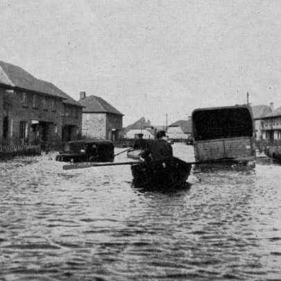 At Canvey every house was evacuated and the last boat load of rescued people pass through silent and stricken streets