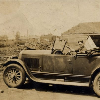 George's uncle, Jack Hoy in an old Buick that was a permanent fixture in the farmyard for many years. | G.Chambers
