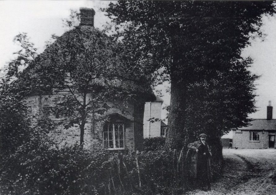 An early photo of the Dutch Cottage in Haven Road with The Red Cow PH in the distance on the right