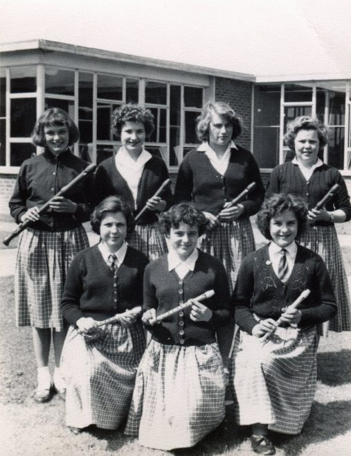The recorder group photo probably taken around 1958. Back row is me Helen Barrnes (then) , ? , ? , Cherry Morton at the end.  Front row Jenny Stevens , ?  Helen Bishop at the end. | Helen Thurlow