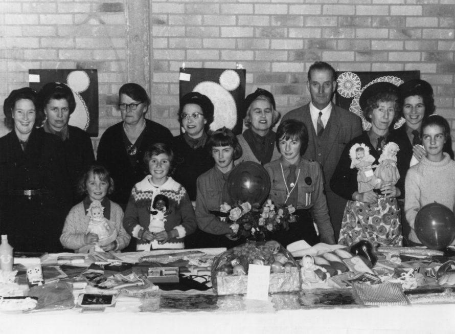 Christmas Bazaar St Nicholas Church Hall not sure which year. Looks like Phyllis Owens third from the right holding the two dolls | Phyllis Owens