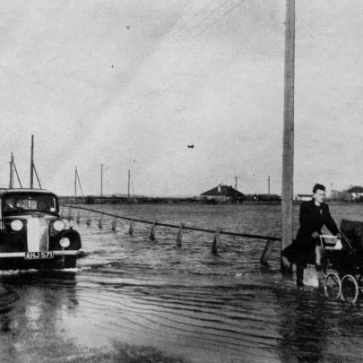 A resident wheels all his remaining belongings in a pram along the flooded High Road at Canvey Island. Many people escaped with only the drenched clothes they stood up in