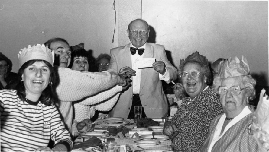 Phoenix Club Xmas Dinner 1990 with £500 cheque | Echo Newspaper Archive