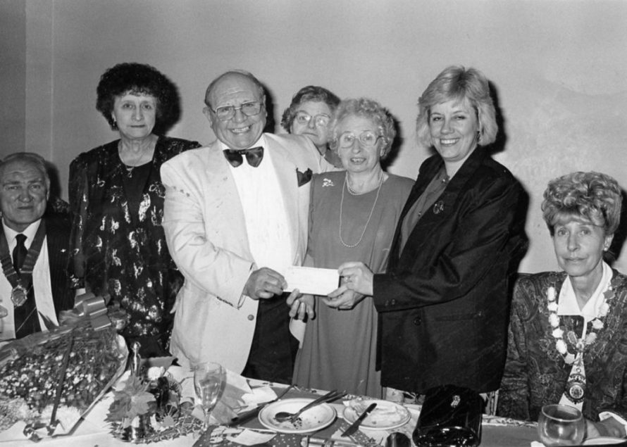 Phoenix Club Xmas Dinner 1991 Eddie presents a cheque for £600 to Linda Marsh secretary of the Tesco Trust. | Echo Newspaper Archive
