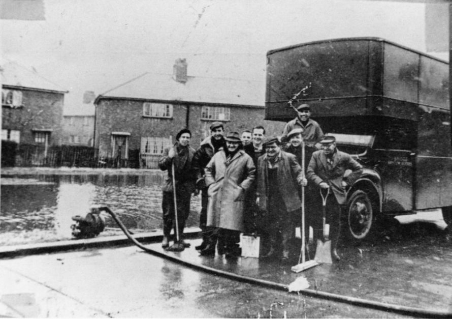 Warm smiles on a bitter day at Canvey from men who pumped water from homes, shovelled away the mud and generally brought help and hope to flood victims.