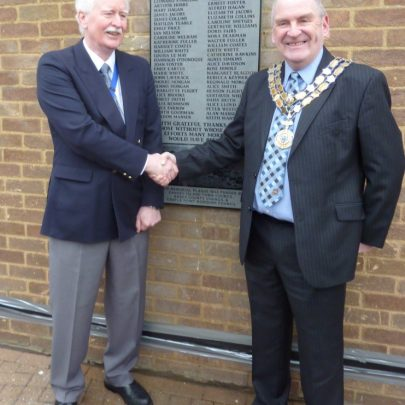 A very cold Canvey Island Town Council Chairman Cllr John Anderson and Castle Point Mayor David Cross with the New Plaque. | Janet Penn
