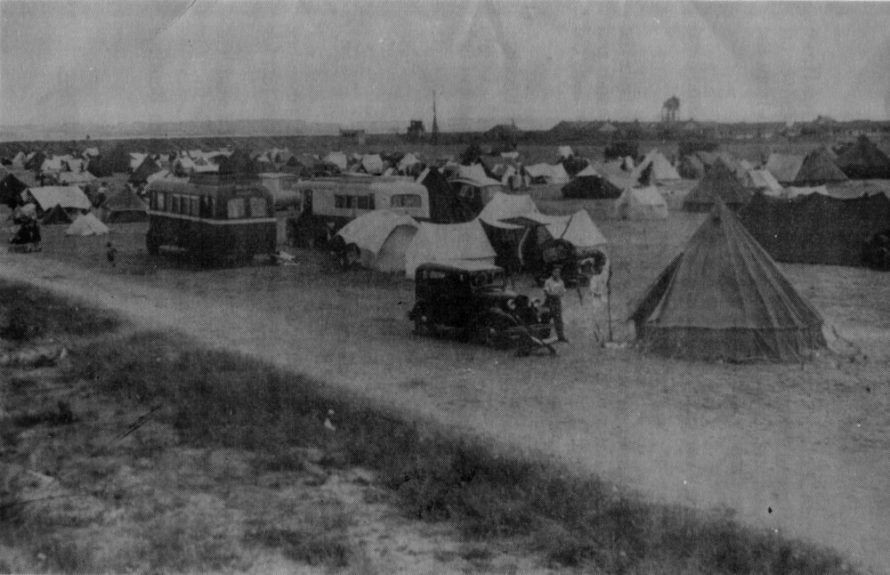 Bringing your own accommodation was the order of the day when Fielder opened up his field to campers. You can see 'Our Lady of Canvey' and the wartime defences in the distance.