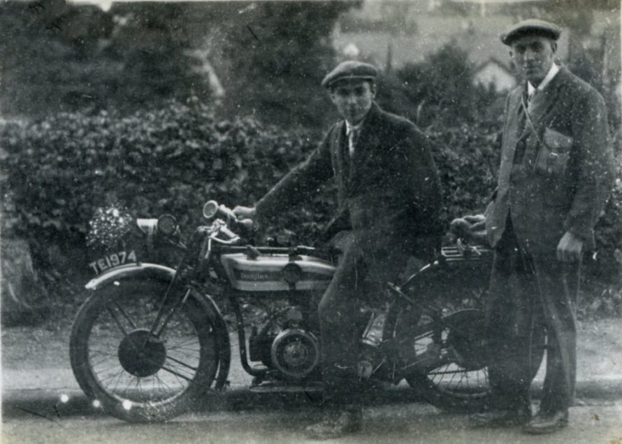 Henry Clubb - Photographer and his son. The motor-cycle is a Douglas. c1930