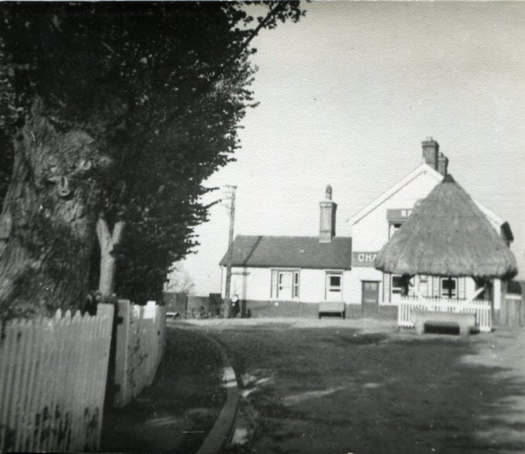 Looking North up Haven Road towards the pump and the Red Cow PH   H Read