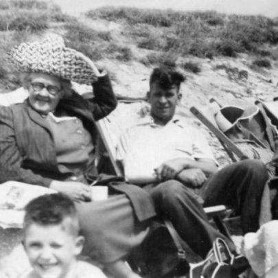 Pat's family by the cafe 1952. You can see the pre flood seawall. | Pat Bailey