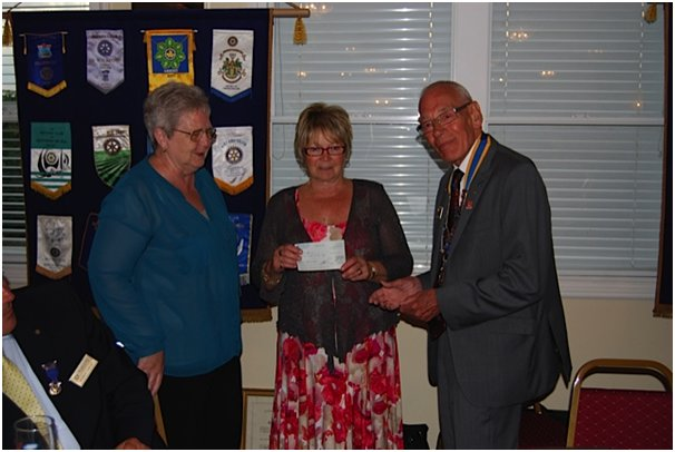 Joan Liddiard and myself receiving a cheque from the newly elected President of the Canvey Rotary Club, Alan Humphreys | Michael Machin