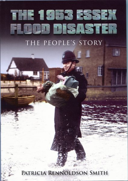 The front cover is a picture of PC Bill Pilgrim carrying a child from her flooded home on Canvey Island | Courtesy of Bob Pilgrim