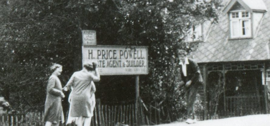 An enlargement showing the sign for H Price Powell, Estate Agent and Builder