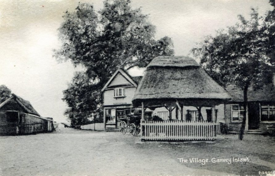 Post Office owned by J Woods and the pump