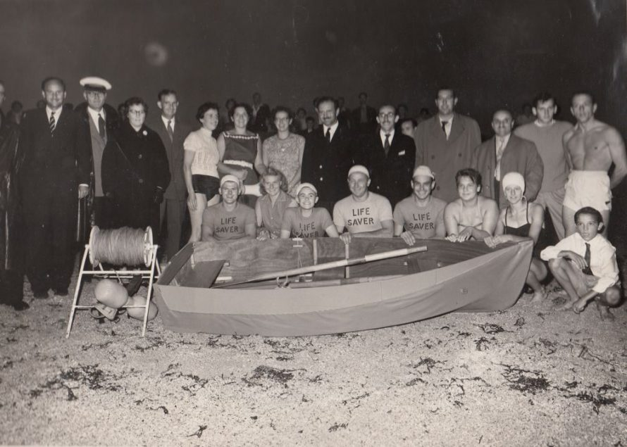 Ron is crouching behind the boat far left. Prout brothers standing in the middle at the back | Ron Reynolds