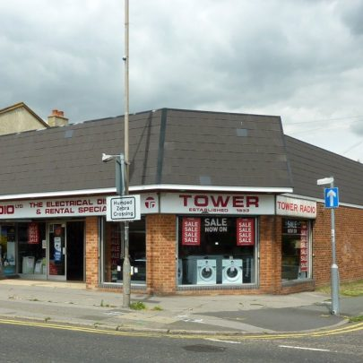 Tower Radio shop at the junction of High Street and Larup Road, built on the site of the original buildings | Janet Penn
