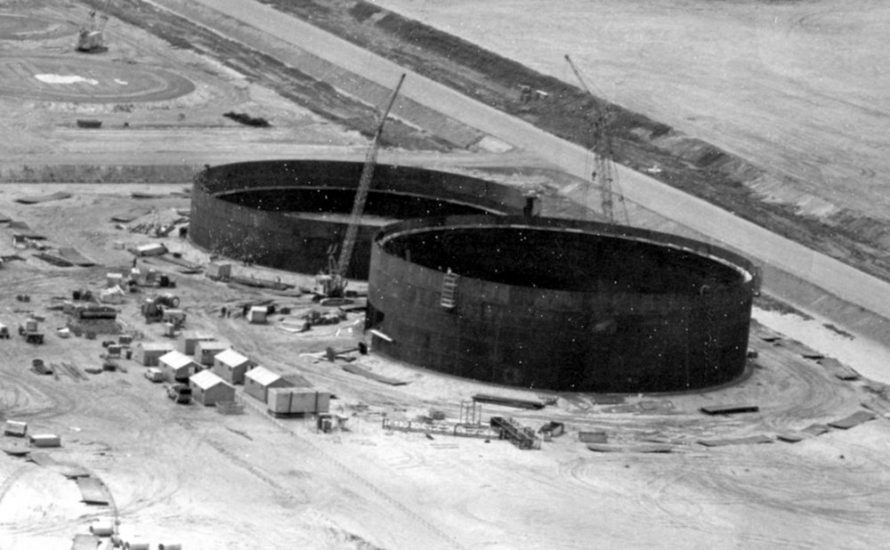 Busy closeup of the construction of two tanks