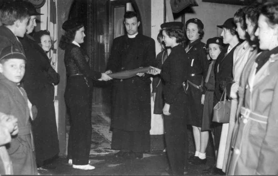 Wednesday 3rd May 1950. Essex Guides Scroll of Friendship for Suomi-Finland being handed to Rev A J Mortimer by the Sea Rangers | Phyllis Owens