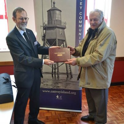 Archive member Bob Johnson passing the remembrance book to Dave Thorndike of the Bay Museum where it will be kept. | Beyond the Point