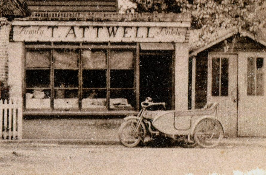 Great close-up of the shop and the motor bike and side car