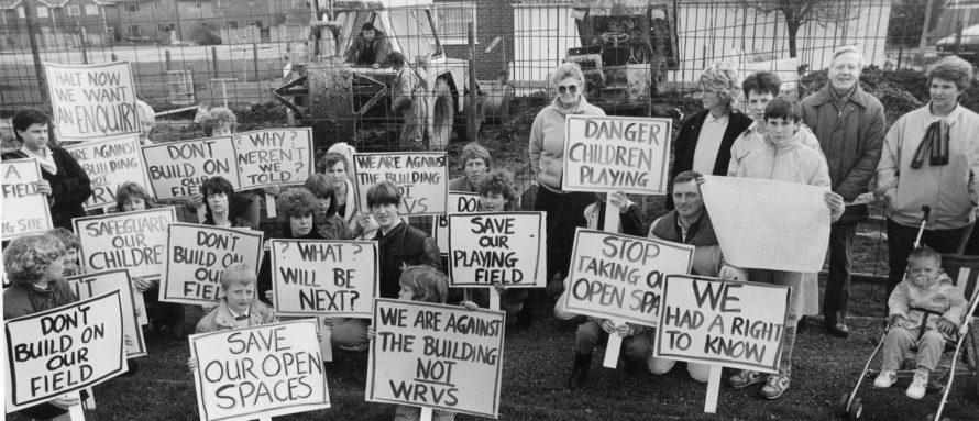 Demo: Families line up with their posters as the builders work on | Echo Newspaper Group