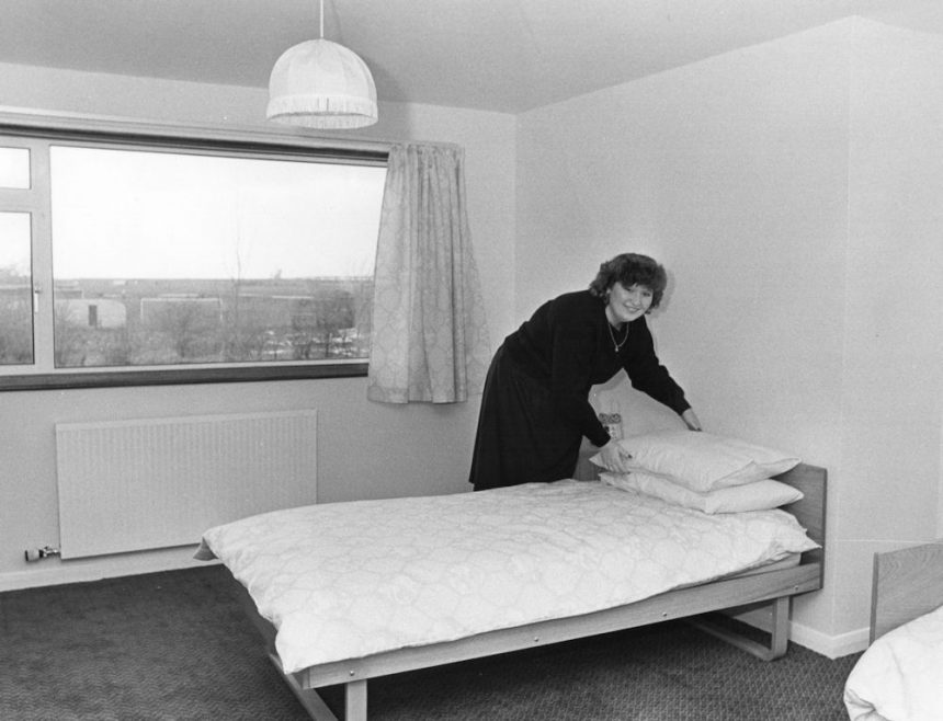 Nurse June Riley making up a bed. Are those caravans I see through the window? | Echo Newspaper Group