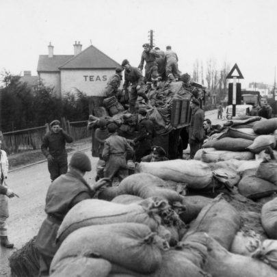 SANDBAGS. The Army or R.A.F. loading a lorry on the corner of Mitchells Ave and High St. | McCave