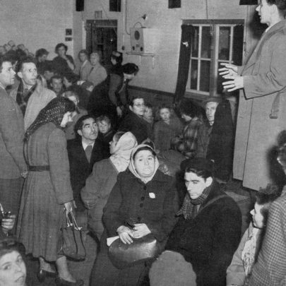 An official at the refugee centre in a Benfleet School giving directions to Canvey Island refugees