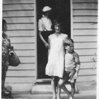 Marjorie and two of her brothers outside the bungalow | Marjorie Parks