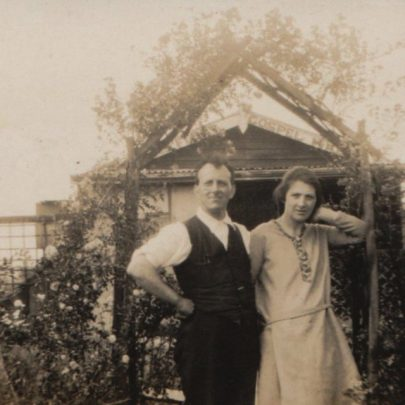 Edwin & Gertrude Milford standing in front of the shed that they lived in when first on Canvey, this was later used as the first gospel hall. You can see the name above the door | George Milford