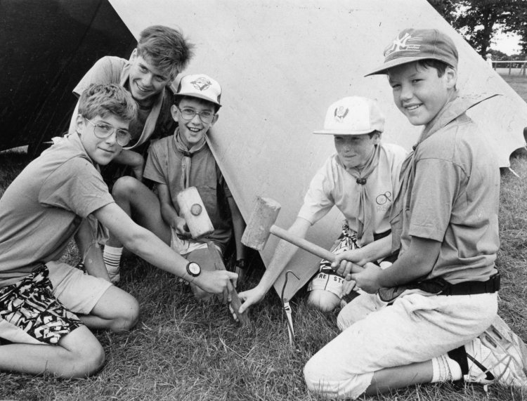 Pitching tent and knocking in a tent peg. | Echo newspaper group and the Rayleigh Town Museum