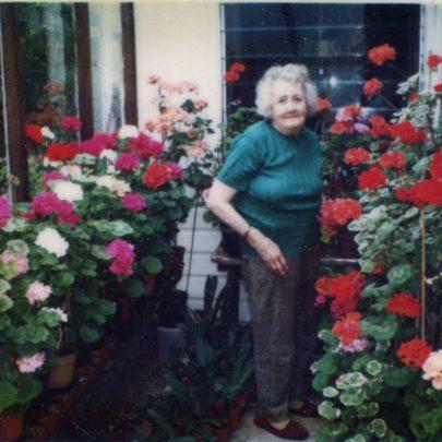 h).Mrs Bevan with her cherished geraniums. | N.Bevan.