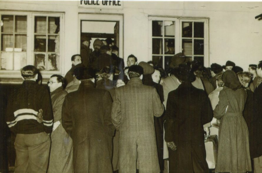 Waiting to be evacuated. Crowds at the police office at the Council Offices, some with bags packed waiting for the mass evacuation after the floods that devastated Canvey in 1953. Were you there, can you tell us more. Please comment below.