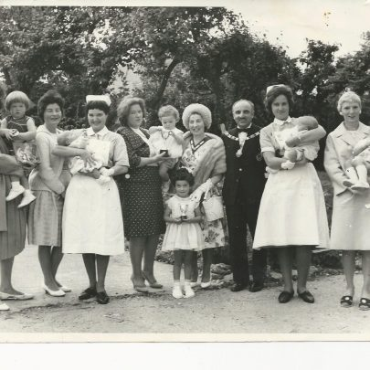 Photo 4 is Elsie Pickett proudly looking over the nurses shoulder to look at one of her twin boys other being on the right in another nurses arms.